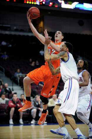 UTSA's Jeromie Hill (12) shoots against Louisiana Tech's Michale Kyser during the first half of a Western Athletic Conference tournament NCAA college basketball game on Thursday, March 14, 2013, in Las Vegas. (AP Photo/David Becker) Photo: David Becker, Associated Press / FR170737 AP