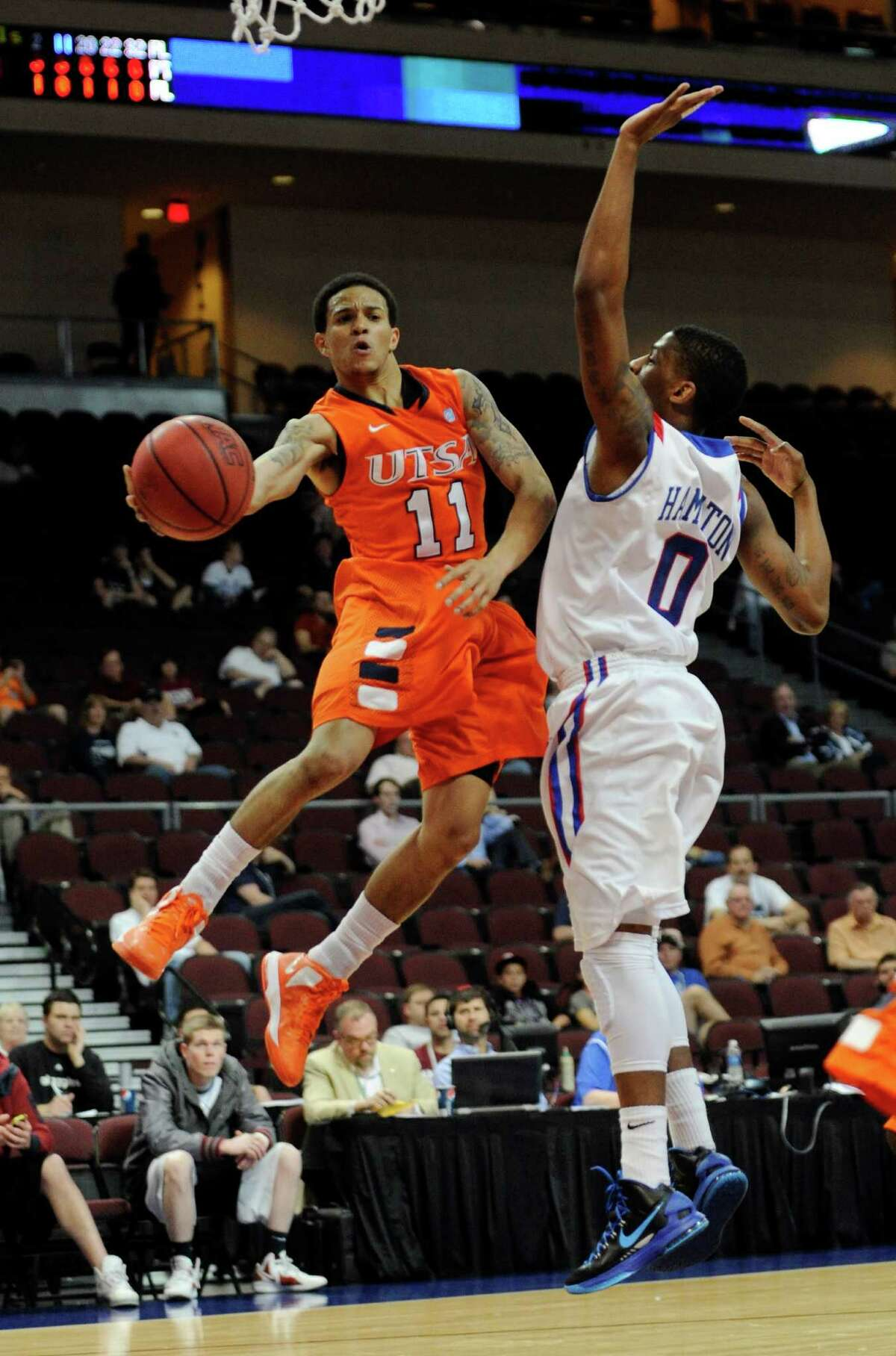 UTSA's Michael Hale III (11) makes an under-the-basket pass around Louisiana Tech's Alex Hamilton during the first half of a Western Athletic Conference tournament NCAA college basketball game on Thursday, March 14, 2013 in Las Vegas. (AP Photo/David Becker)