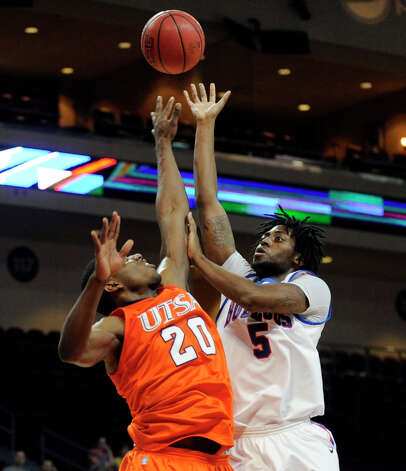 Louisiana Tech's Chris Anderson (5) shoots over UTSA's Edrico McGregor during the second half of a Western Athletic Conference tournament NCAA college basketball game on Thursday, March 14, 2013, in Las Vegas. UTSA won 73-67. (AP Photo/David Becker) Photo: David Becker, Associated Press / FR170737 AP