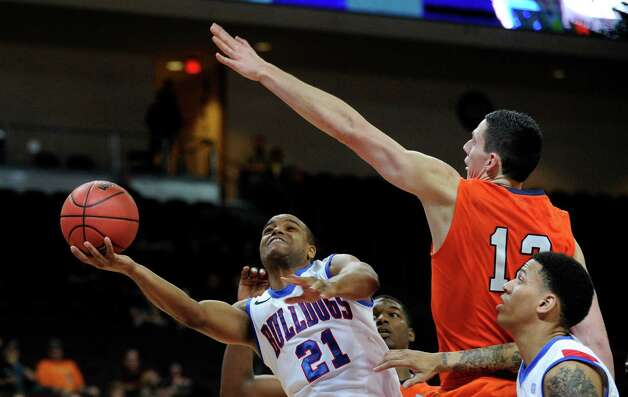 Louisiana Tech's Kenyon McNeail (21) shoots against UTSA's Jeromie Hill during the second half of a Western Athletic Conference tournament NCAA college basketball game on Thursday, March 14, 2013, in Las Vegas. UTSA won 73-67. (AP Photo/David Becker) Photo: David Becker, Associated Press / FR170737 AP