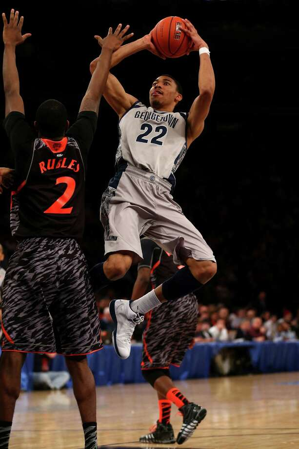 Otto Porter Jr., who led Georgetown with 18 points, pulls up for a shot against Cincinnati. Photo: Elsa, Staff / 2013 Getty Images