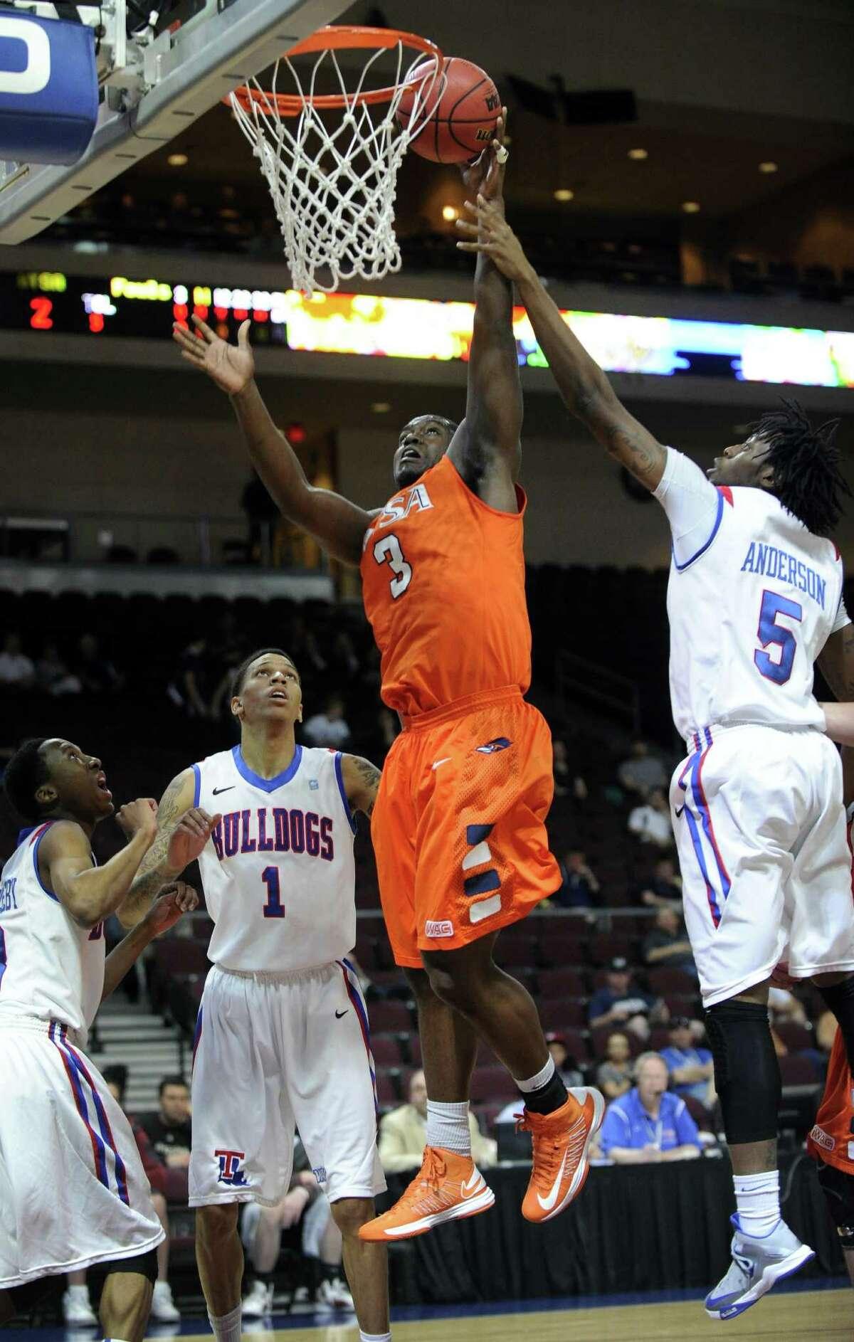 UTSA's Larry Wilkins shoots against Louisiana Tech's Chris Anderson (right) on Thursday in Las Vegas.