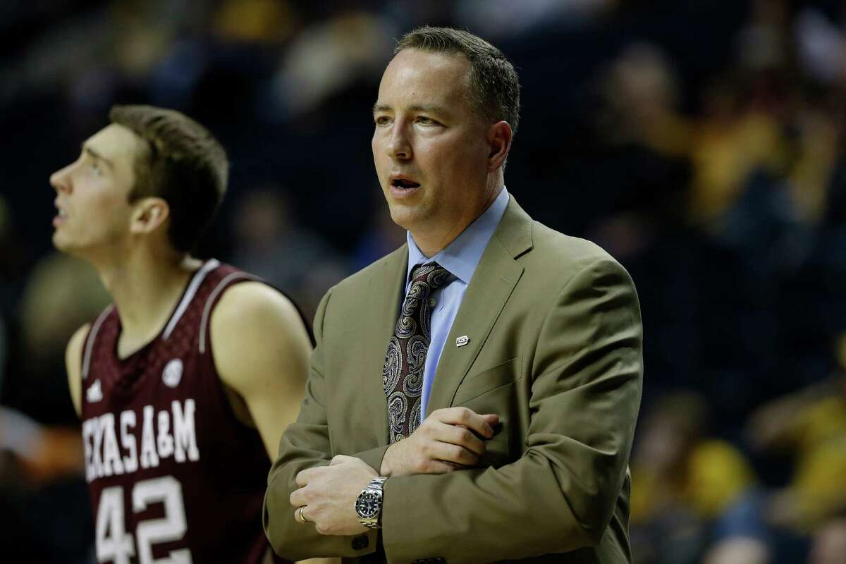 Texas A&M head coach Billy Kennedy watches play as Texas A&M forward Jarod Jahns (42) looks on during the second half of an NCAA college basketball game against the Missouri at the Southeastern Conference tournament, Friday, March 15, 2013, in Nashville, Tenn. (AP Photo/Dave Martin)