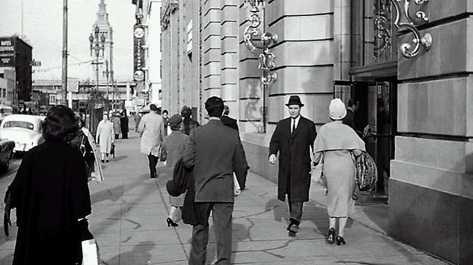 """Jack Lemmon (in dark hat) is seen leaving the Pacific Gas & Electric Co. building on Market Street in a scene from """"Days of Wine and Roses."""" Photo: Warner Bros. 1962"""