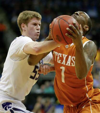 Texas guard Sheldon McClellan (1) is fouled by Kansas State guard Will Spradling (55) during the first half of an NCAA college basketball game in the Big 12 tournament on Thursday, March 14, 2013, in Kansas City, Mo. (AP Photo/Orlin Wagner) Photo: Orlin Wagner, Associated Press / AP