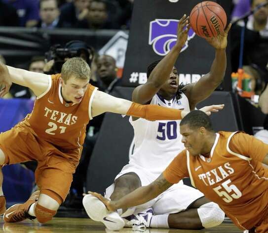 Kansas State forward D.J. Johnson (50) passes to a teammate while covered by Texas forward Connor Lammert (21) and center Cameron Ridley (55) during the second half of an NCAA college basketball game in the Big 12 tournament on Thursday, March 14, 2013, in Kansas City, Mo. Kansas State defeated Texas 66-49. (AP Photo/Orlin Wagner) Photo: Orlin Wagner, Associated Press / AP