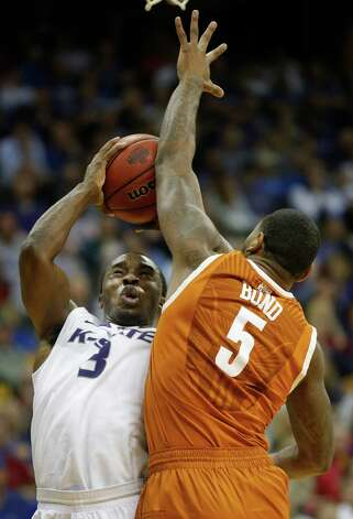 Kansas State guard Martavious Irving (3) shoots over Texas forward Jaylen Bond (5) during the second half of an NCAA college basketball game in the Big 12 tournament on Thursday, March 14, 2013, in Kansas City, Mo. Kansas State defeated Texas 66-49. (AP Photo/Orlin Wagner) Photo: Orlin Wagner, Associated Press / AP