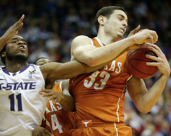 Texas forward Ioannis Papapetrou (33) rebounds against Kansas State forward Nino Williams (11) during the second half of an NCAA college basketball game in the Big 12 tournament on Thursday, March 14, 2013, in Kansas City, Mo. Kansas State defeated Texas 66-49. (AP Photo/Orlin Wagner) Photo: Orlin Wagner, Associated Press / AP