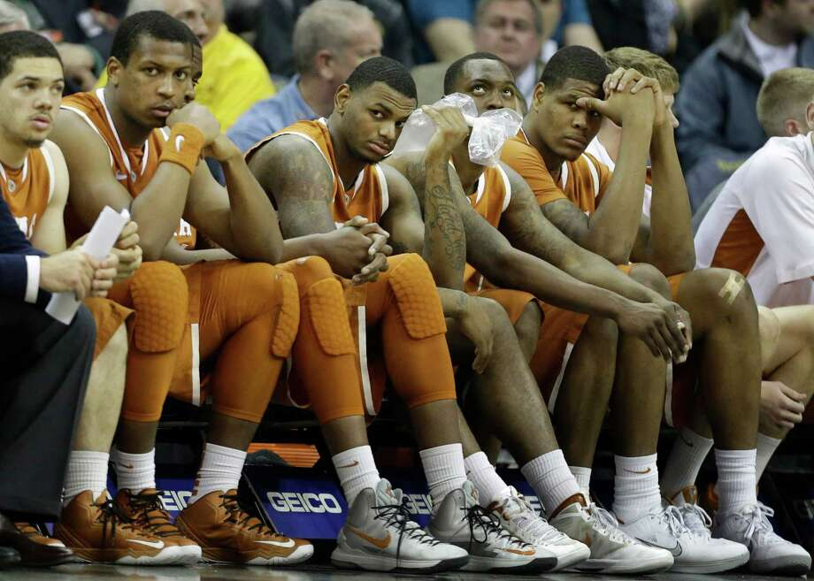 Texas players sit on the bench during the final minutes of an NCAA college basketball game in the Big 12 tournament on Thursday, March 14, 2013, in Kansas City, Mo. Kansas State defeated Texas 66-49. (AP Photo/Orlin Wagner) Photo: Orlin Wagner, Associated Press / AP