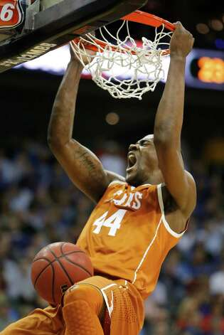 Texas center Prince Ibeh (44) dunks during the first half of an NCAA college basketball game against Kansas State in the Big 12 tournament on Thursday, March 14, 2013, in Kansas City, Mo. (AP Photo/Orlin Wagner) Photo: Orlin Wagner, Associated Press / AP