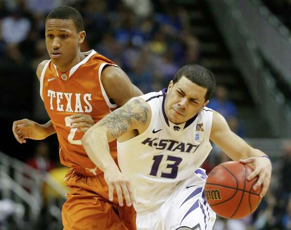 Kansas State guard Angel Rodriguez (13) is fouled by Texas guard Demarcus Holland (2) during the second half of an NCAA college basketball game in the Big 12 tournament on Thursday, March 14, 2013, in Kansas City, Mo. Kansas State defeated Texas 66-49. (AP Photo/Orlin Wagner) Photo: Orlin Wagner, Associated Press / AP