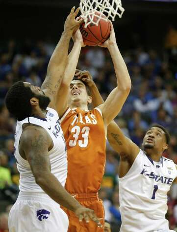 Texas forward Ioannis Papapetrou (33) tries to shoot against Kansas State guard Shane Southwell (1) and forward Thomas Gipson (42) during the first half of an NCAA college basketball game in the Big 12 tournament on Thursday, March 14, 2013, in Kansas City, Mo. (AP Photo/Orlin Wagner) Photo: Orlin Wagner, Associated Press / AP