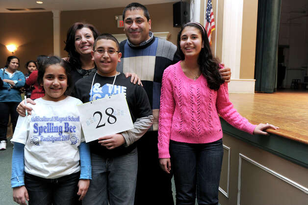 Abram Mikhaeel Goda, 12, of Bridgeport, winner of the Hearst Media Services Regional Spelling Bee, is photographed with his family Thursday night, March 14, 2013. They are from left, sister Natilie Mikhaeel, 8, also a spelling bee participant, parents Bahieh Jabboury and Michael Mikhaeel, and sister Martina Mikhaeel Goda. Photo: Carol Kaliff / The News-Times