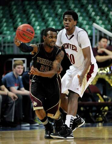 Texas State's Deonte' Jones (23) passes the ball as Denver's Royce O'Neale guards during the second half of a Western Athletic Conference tournament NCAA college basketball game on Thursday, March 14, 2013, in Las Vegas. Texas State won 72-68. (AP Photo/David Becker) Photo: David Becker, Associated Press / FR170737 AP