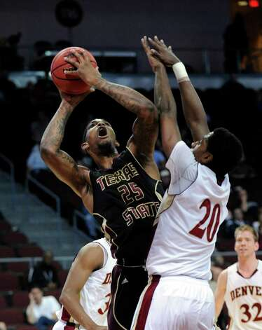Texas State's Joel Wright (25) shoots against Denver's Royce O'Neale (20) during the fist half of a Western Athletic Conference tournament NCAA college basketball game on Thursday, March 14, 2013, in Las Vegas. Texas State won 72-68. (AP Photo/David Becker) Photo: David Becker, Associated Press / FR170737 AP