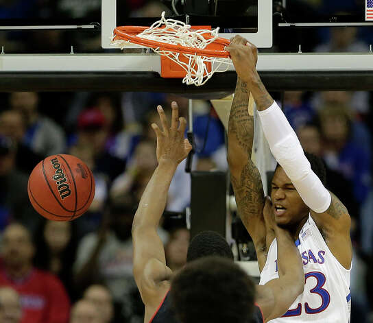 Kansas guard Ben McLemore (23) dunks the ball during the first half an NCAA college basketball game against Texas Tech in the Big 12 men's tournament Thursday, March 14, 2013, in Kansas City, Mo. (AP Photo/Charlie Riedel) Photo: Charlie Riedel, Associated Press / AP