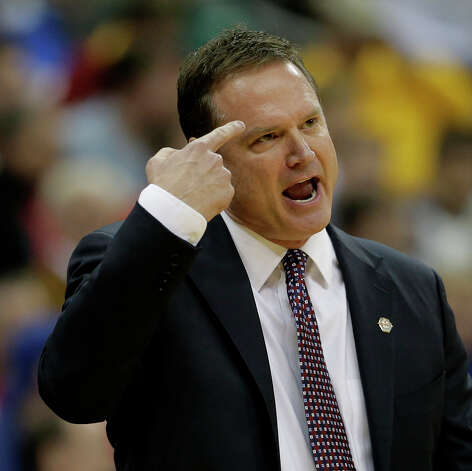 Kansas coach Bill Self talks to a player during the first half an NCAA college basketball game against Texas Tech in the Big 12 men's tournament on Thursday, March 14, 2013, in Kansas City, Mo. (AP Photo/Charlie Riedel) Photo: Charlie Riedel, Associated Press / AP