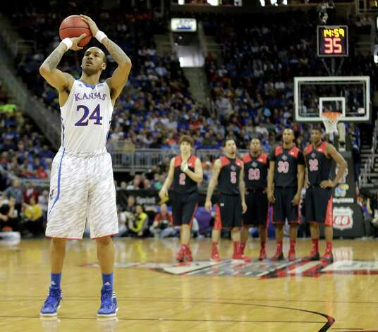 Kansas guard Travis Releford (24) shoots after being fouled during the second half an NCAA college basketball game against Texas Tech in the Big 12 men's tournament on Thursday, March 14, 2013, in Kansas City, Mo. (AP Photo/Charlie Riedel) Photo: Charlie Riedel, Associated Press / AP