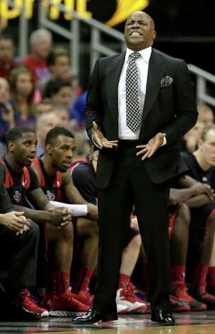 Texas Tech coach Chris Walker reacts to a call during the first half of an NCAA college basketball game against Kansas in the Big 12 men's tournament Thursday, March 14, 2013, in Kansas City, Mo. (AP Photo/Charlie Riedel) Photo: Charlie Riedel, Associated Press / AP