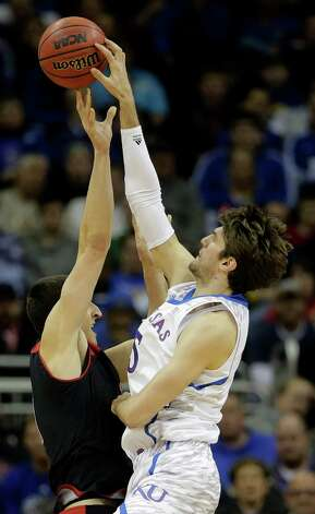Kansas center Jeff Withey (5) blocks a shot by Texas Tech forward Dejan Kravic (11) during the second half an NCAA college basketball game in the Big 12 men's tournament on Thursday, March 14, 2013, in Kansas City, Mo. (AP Photo/Charlie Riedel) Photo: Charlie Riedel, Associated Press / AP