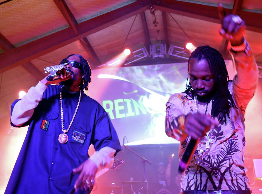 Snoop Dogg, aka Snoop Lion, (left) and Mavado perform at Viceland during South by Southwest Thursday March 14, 2013 in Austin, TX. Photo: Edward A. Ornelas, San Antonio Express-News / © 2013 San Antonio Express-News