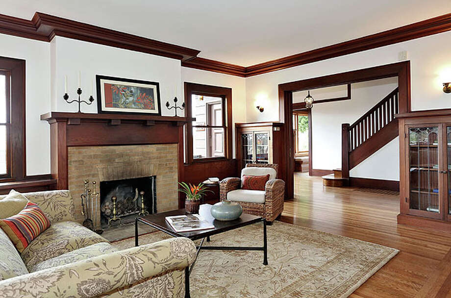 The living room shows Craftsman details. The architect was Walter Ratcliff.