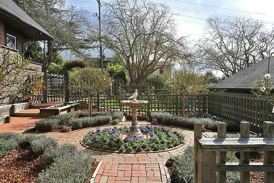 The house has extensive gardens.