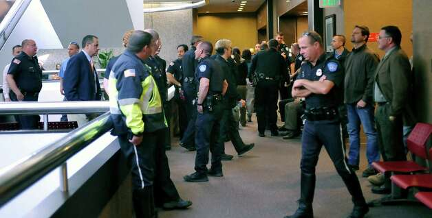 "About 50 Beaumont police officers and officials wait outside the courtroom for the outcome.  John Wesley Nero, who has been charged with capital murder in the death of Police Officer Bryan Hebert, had an appearance in John Stevens Jr.,Criminal District courtroom Thursday morning March 14, 2013.   He plead ""no contest"" and received life in prison without parole. Dave Ryan/The Enterprise"