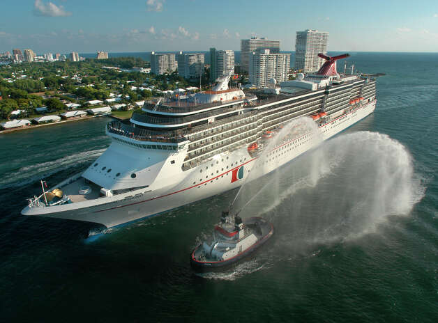 "FILE - The Carnival Legend, a 2,100-passenger, 960-foot-long cruise ship arrives at Port Everglades in Fort Lauderdale, Fla., in this Nov. 8, 2002 file photo. Carnival Cruise Lines says another of its ships has experienced problems and is heading back to the Port of Tampa. Late Thursday, March 14, 2013 the company said ""a technical issue"" affecting the sailing speed of the Legend forced the cancellation of a stop at Grand Cayman Islands. The Carnival Dream experienced problems with an on-board generator while docked in St. Maarten and the company announced Thursday that passengers would be flown home. (AP Photo/Carnival Cruise Lines, Andy Newman, File) Photo: ANDY NEWMAN, HOEP / CARNIVAL CRUISE LINES"