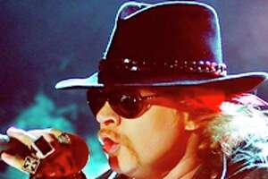 """3000 x 2197~~$~~FILE - This Dec. 7, 2012 file photo shows Axl Rose, lead vocalist of Guns N' Roses performing during their concert in Bangalore, India. A judge on Wednesday Feb. 20, 2013 dismissed Rose's lawsuit against Activision Blizzard Inc. The Guns N' Roses rocker had claimed the gaming giant violated an agreement not to feature guitarist Slash in a """"Guitar Hero"""" video game."""