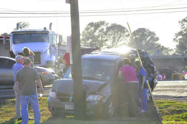 An 18-wheeler and a van wrecked just after 6 p.m. Thursday at the intersection of E. Candlestick Drive and North Main Street in Lumberton. The woman in the van was taken to the hospital. Photo: Cassie Smith