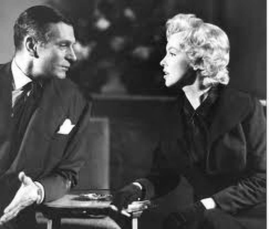 The Prince and the Showgirl -- one of the least successful romantic  pairings, Laurence Olivier and Marilyn Monroe.