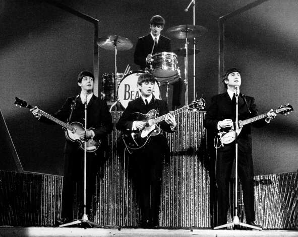 The four members of the group the Beatles performing at the London Palladium in front of 2,000 fans. Photo: Getty Images