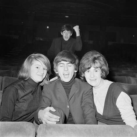 Paul McCartney of the Beatles photo-bombs George Harrison in 1963. Photo: Mark And Colleen Hayward, Getty Images / 2009 Getty Images