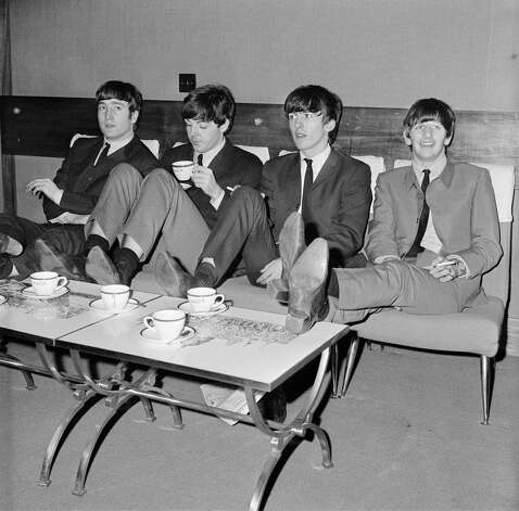 The Beatles relax backstage at London's Prince of Wales Theatre, before the Royal Variety Performance in November 1963. They are supporting Marlene Dietrich in the show. Photo: Mark And Colleen Hayward, Getty Images / 2009 Getty Images