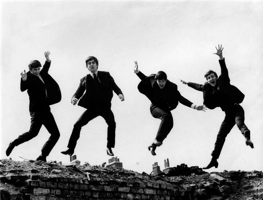 This shot of the Beatles leaping was used on the Twist & Shout EP cover. Photo: Fiona Adams, Getty Images / Redferns