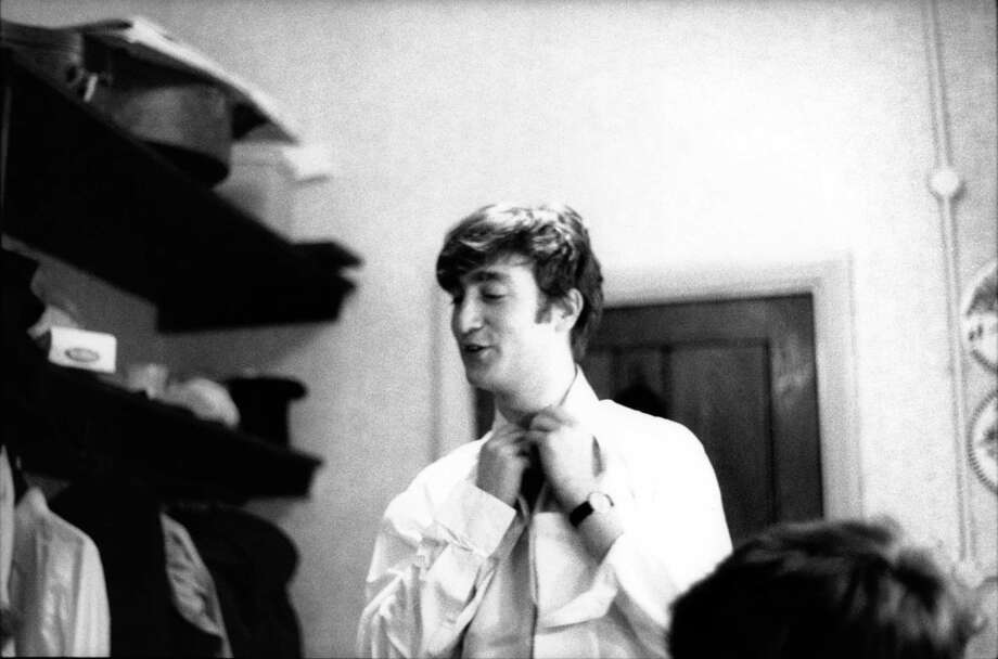 John Lennon from The Beatles posed backstage at the Finsbury Park Astoria, London during the band's Christmas Show residency in December 1963. Photo: Val Wilmer, Getty Images / Redferns