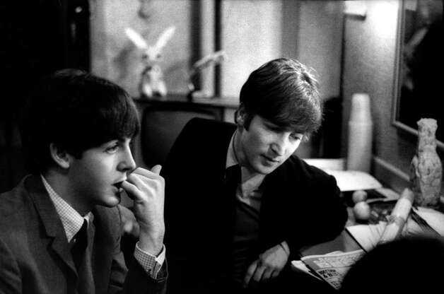 Paul McCartney and John Lennon from The Beatles posed backstage at the Finsbury Park Astoria, London during the band's Christmas Show residency in December 1963. Photo: Val Wilmer, Getty Images / Redferns