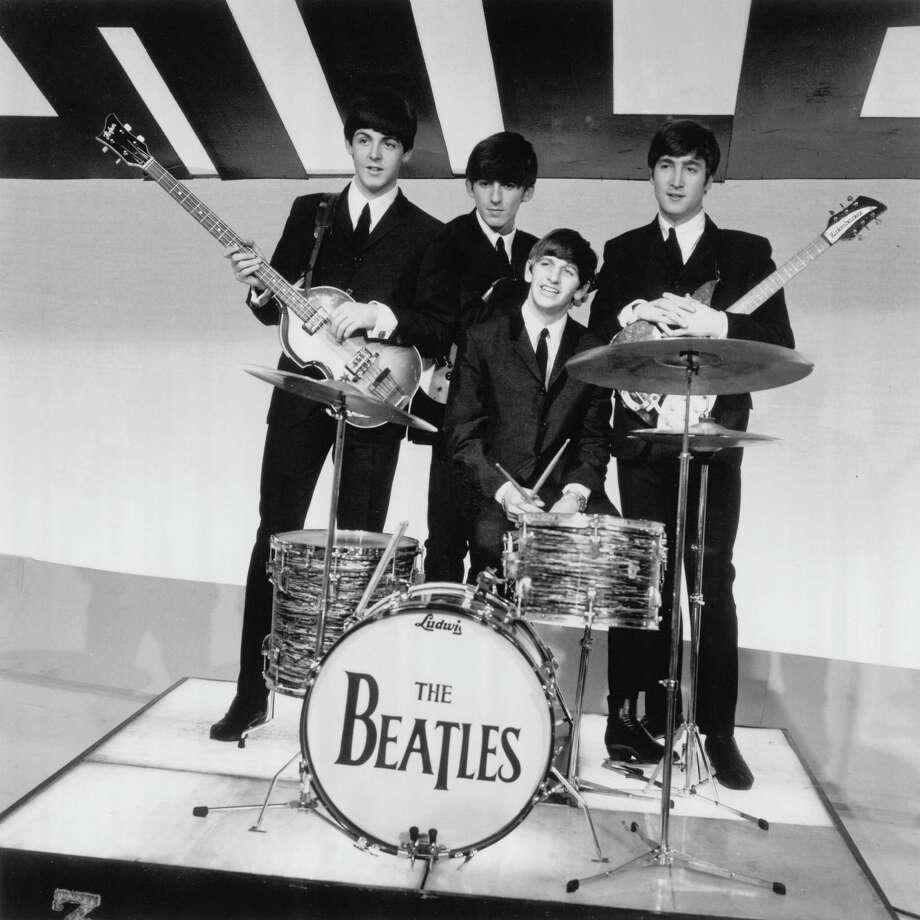 Paul McCartney, George Harrison, Ringo Starr & John Lennon pose at Alpha Television Studios, Aston, Birmingham. Photo: David Redfern, Getty Images / Redferns