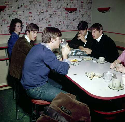 English pop group The Beatles at a meal break in a canteen, 1963. Photo: Paul Popper/Popperfoto, Getty Images / 2009 Getty Images