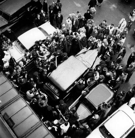 Fans and paparazzi surround the limousine belonging to the Beatles as the famous pop group embark upon their UK Tour. Photo: Popperfoto, Getty Images / Popperfoto