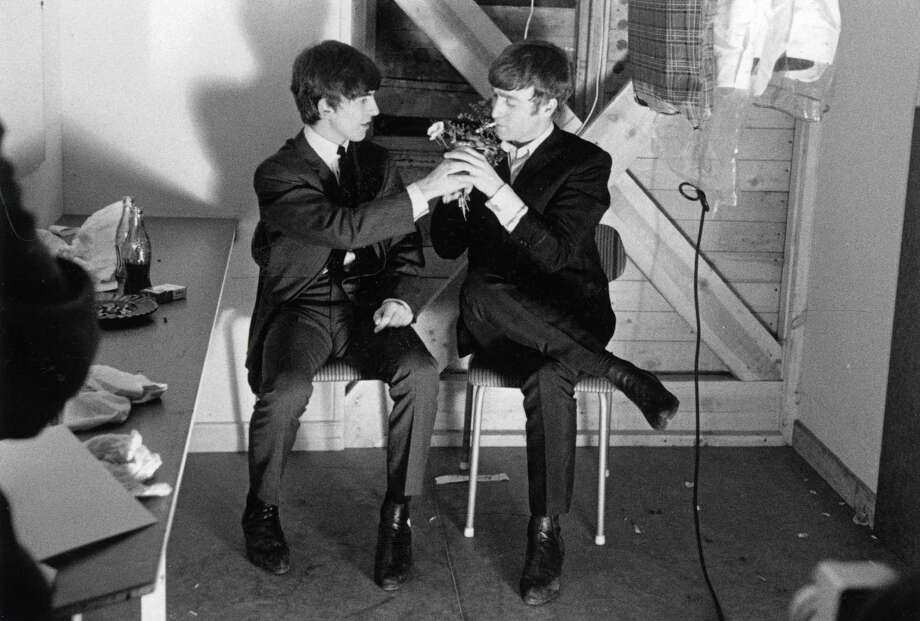 The Beatles in Stockholm, Sweden, 1963, John Lennon (right) has his cigarette lit by George Harrison in their dressing room prior to a Swedish TV show Photo: Popperfoto, Getty Images / Popperfoto
