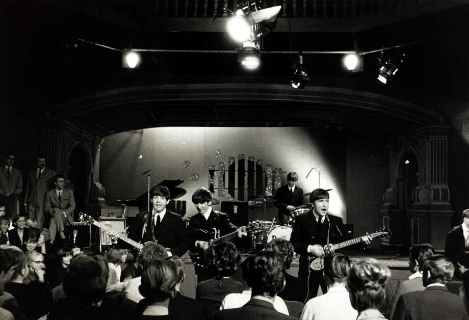 The Beatles performing before an audience in a Swedish TV studio. Photo: Popperfoto, Getty Images / Popperfoto