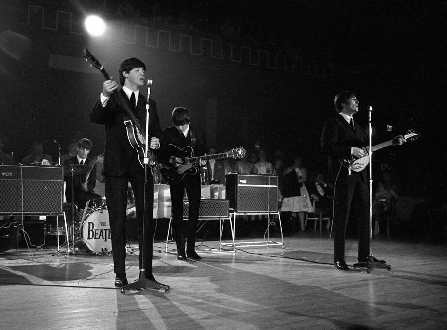The Beatles performing on stage during a concert in 1963 Photo: Popperfoto, Getty Images / Popperfoto