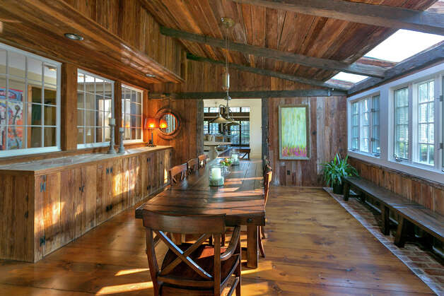 The sunken formal living room features walls and a ceiling paneled in barn wood and a built-in buffet. Photo: Contributed Photo