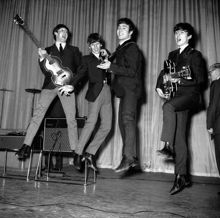 The Beatles rehearse for that night's Royal Variety Performance at the Prince of Wales Theatre in November 1963. Photo: Central Press, Getty Images / 2005 Getty Images