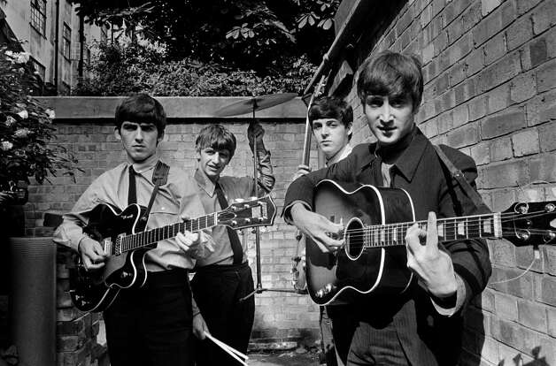 The Beatles pose in a small backyard in London with their instruments in 1963. Photo: Terry O'Neill, Getty Images / 2005 Getty Images