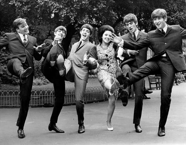 High kicking winners of the Melody Maker poll awards for 1963, from left; Billy J Kramer, who won the 'Best Hope For 1963' award, The Beatles, who won 'Top Vocal Group' and, between Beatles Paul and George, Susan Maughan, who won the award for 'Top Female Singer'. Photo: Keystone, Getty Images / Hulton Archive