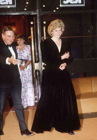 Diana, Princess of Wales at The Barbican for a performance of 'Les Miserables' wearing a black velvet evening dress designed by Bruce Oldfield which will be auctioned this month. Photo: Tim Graham, Tim Graham/Getty Images / Tim Graham Photo Library
