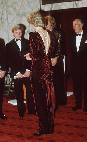 Diana, Princess of Wales attends the premiere of 'Back To The Future' at The Empire Cinema, Leicester Square, London wearing a burgundy velvet evening dress designed by Catherine Walker which will be auctioned this month. Photo: Tim Graham, Tim Graham/Getty Images / Tim Graham Photo Library